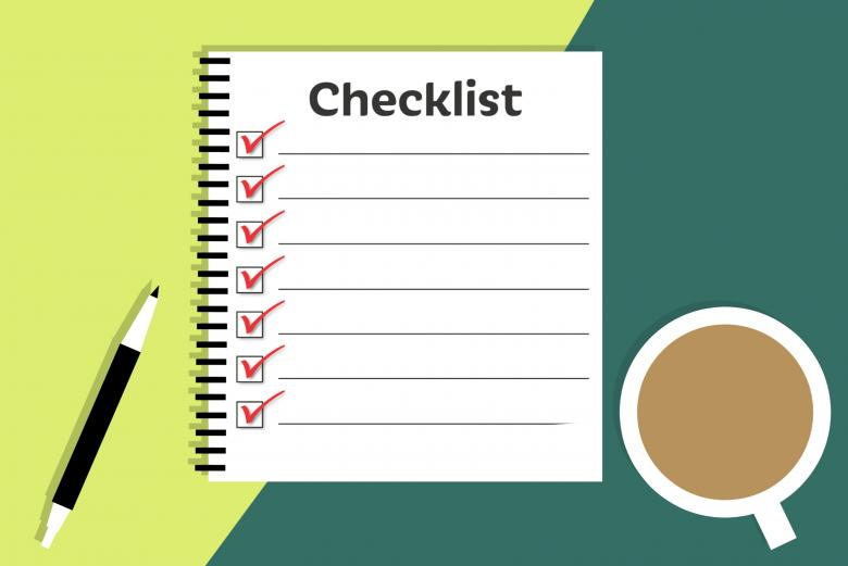 notebook with checklist, pen, and cup of coffee